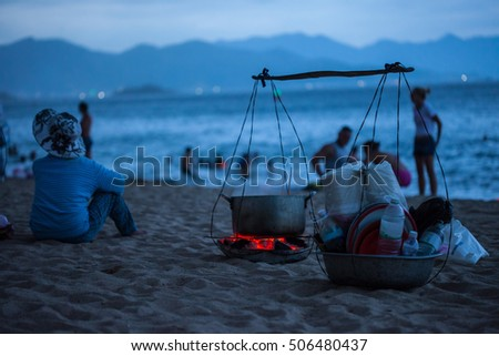 cooking equipment on sea shore at dusk
