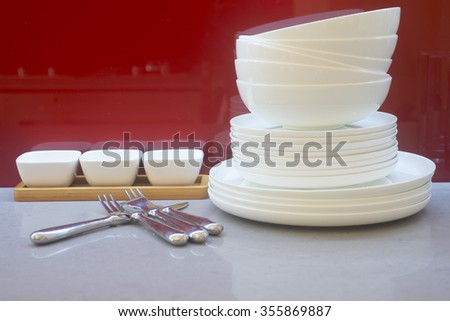 Cookware and dishes on table
