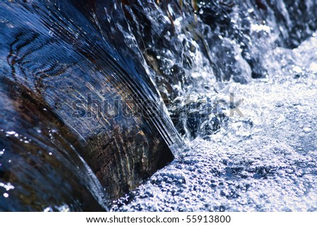 cool rushing water in natural stream