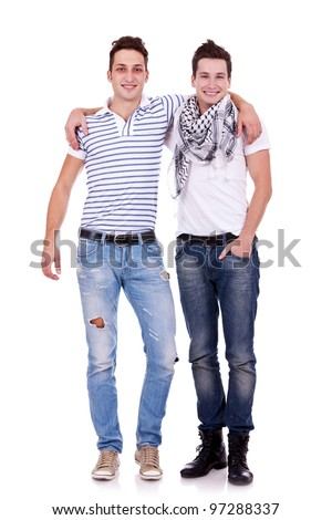Cool two friends guys standing with hands on shoulders and looking at you isolated on white background