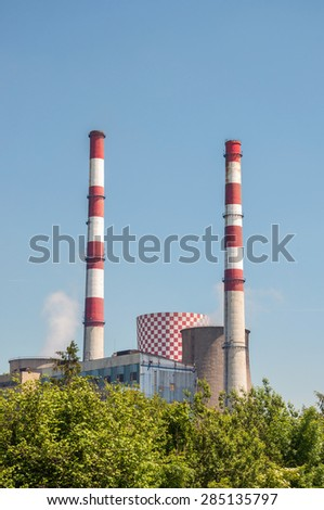 Cooling tower and chimneys of coal power plant.