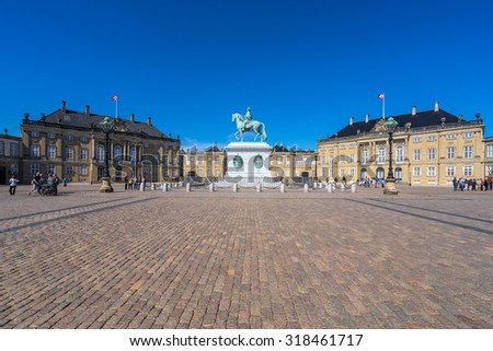 COPENHAGEN, DENMARK - JUNE 05, 2015: People visit the Amelienborg Palace in the Danish capital city Copenhagen. It is a residence of the Danish royal family.