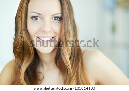 stock photo copy spaced portrait of a young charming lady looking at camera with smile 185014133