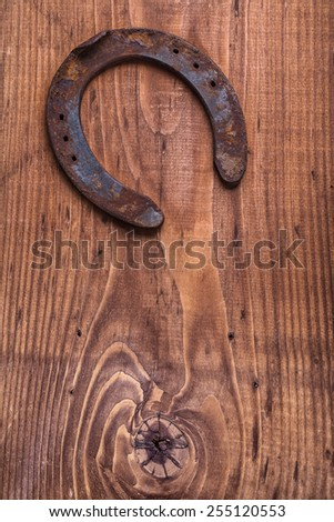 copyspace image the old rusty horseshoe on vintage wooden board happy concept