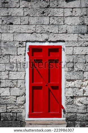 coral stone houses with red shutter in Caribbean