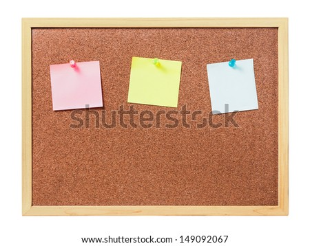 cork board with plastic pins and blank notes