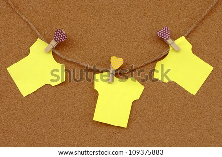 Cork board with yellow notes.
