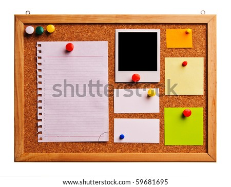 Cork bulletin board with notes, business cards and instant photo cards.