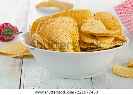 Corn nachos on a wooden background.  Selective focus