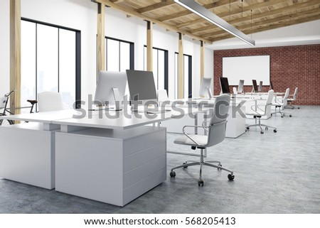 pictures of an office. corner of an office with many tables there are computers standing on them and a pictures