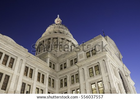 Corner view of Texas State Capitol building at dawn.