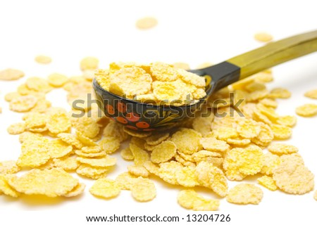 Cornflakes and wood spoon on isolated