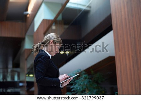 corporate business woman working on tablet computer  at modern office interior