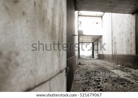 Corridor in the abandoned concrete building