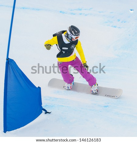CORTINA D'AMPEZZO, ITALY - DECEMBER 22: Unknown snowboarder performs during the European Cup Snowboardcross on December 22, 2012, Cortina d'Ampezzo, Italy