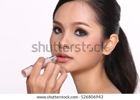 Cosmetic, Applying Make up, Beauty Process, white studio background, Perfect Healthy Skin, Lipstick