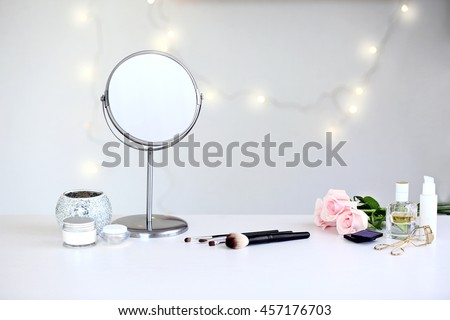Cosmetic set on light dressing table