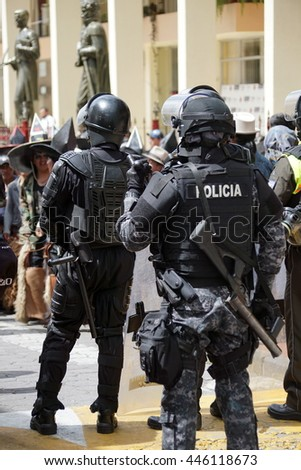 COTACACHI, ECUADOR - JUNE 30, 2016: Inti Raymi, the Quechua solstice celebration, with a history of violence in Cotacachi. Riot police standby in case of violence.