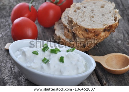 Cottage cheese on  a wooden table