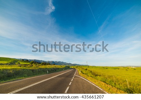 country road under a blue sky in Sardinia, Italy