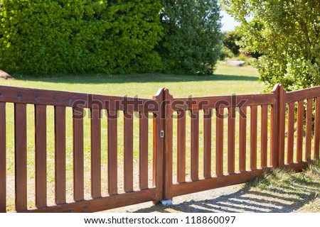 Country Wooden Gate Entry to Courtyard. Sunny day