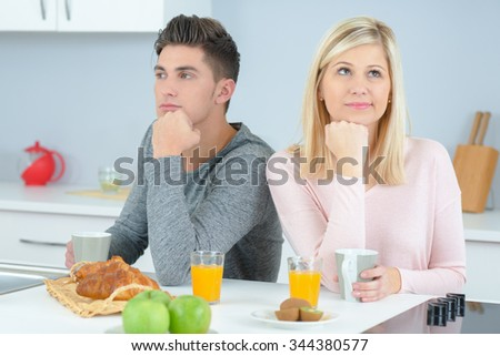 Couple in a bad mood in the kitchen