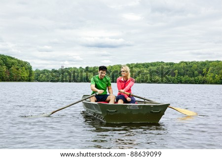 Couple in a rowboat on a lake