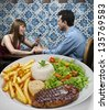 Couple in restaurant - stock photo