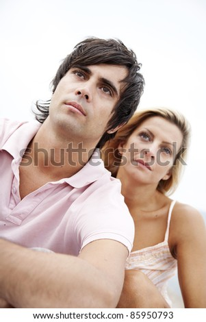couple looking seriously into the distance