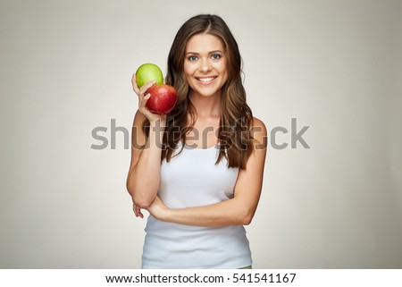 couple of red and green apple smiling woman holding on isolated gray studio background. sporty style white singlet wearing.