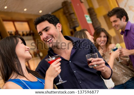 Couple on a date at the bar having drinks