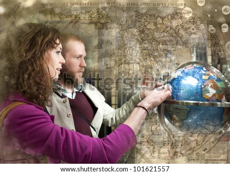 Couple on the date looking at the globe. Travel concept.