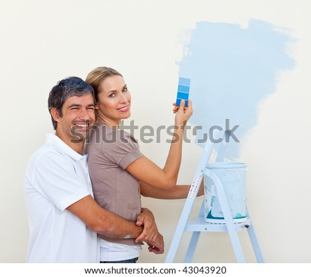 couple painting together in their new house
