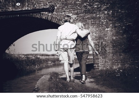 couple walking by the canal