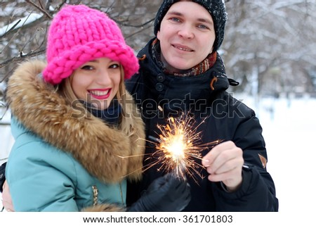 couple with sparklers street