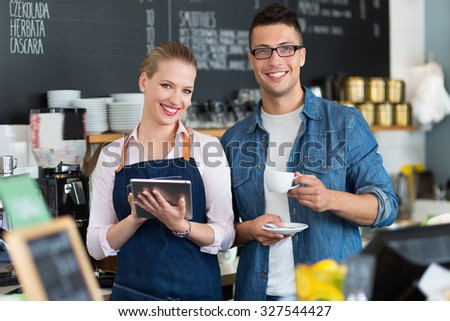Couple working at coffee shop
