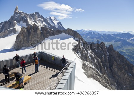 COURMAYEUR, IT - JULY 29, 2016: Unidentified people take a picture on panoramic terrace Punta Helbronner of new SKYWAY MONTE BIANCO terminal in Aosta Valley region of Italy.