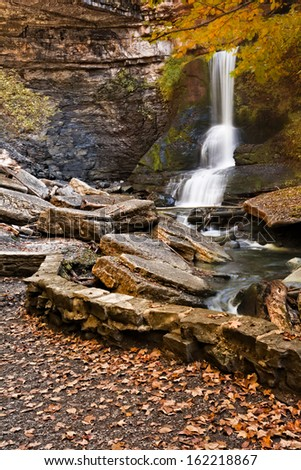 Cow Sheds falls in Filmore Glen New York during fall. A gorgeous waterfall found in the Finger Lakes region.