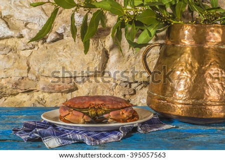Crab and pan with laurel in rustic wooden table