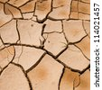 cracked clay ground into the dry season - stock photo