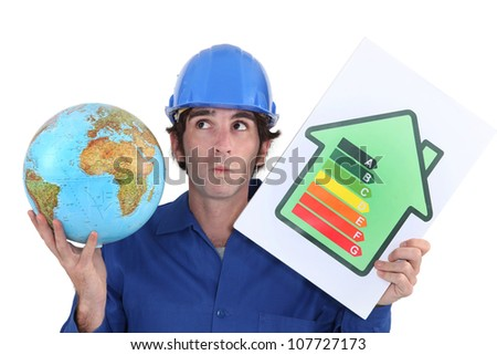 craftsman holding an energy consumption label and a globe