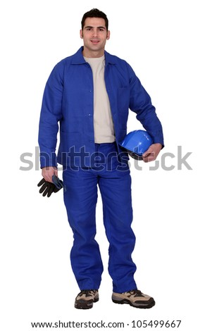 craftsman holding his gloves and a helmet