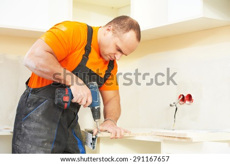 Craftsman kitchen carpenter at kitchen cabinet installation service work
