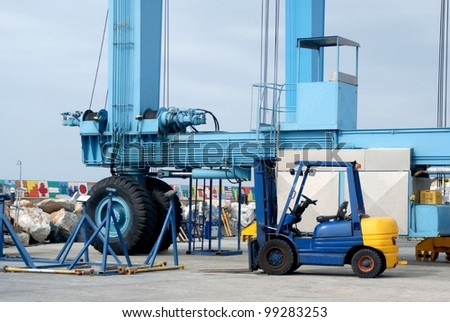 Crane and forklift in port