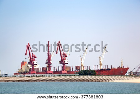 Crane in the port ships background