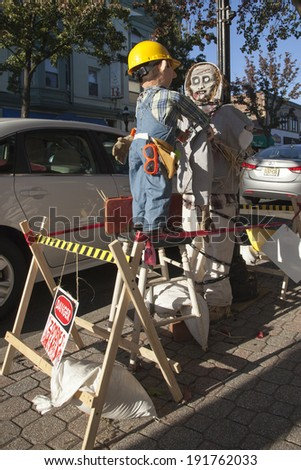 CRANFORD, NJ - OCTOBER 26: Scarecrows from the 6th annual Scarecrow Stroll.  Here, Bob the Builder works on a zombie scarecrow. Photo taken October 26, 2013.