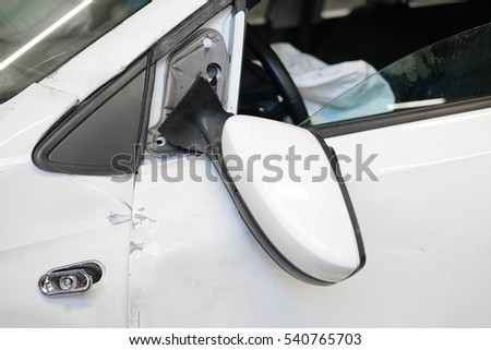 Crashed mirror of a car after exident