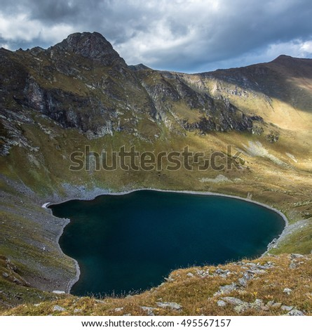 Crater lake in the upper reaches of the river Left Urup. Caucasus mountains. Karachay-Cherkessia. Russia.