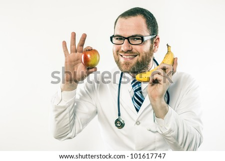 Crazed doctor in glasses and stethoscope wielding apple and banana