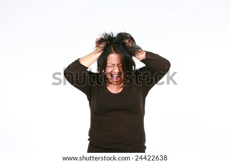 crazy hispanic woman screaming and pulling hair